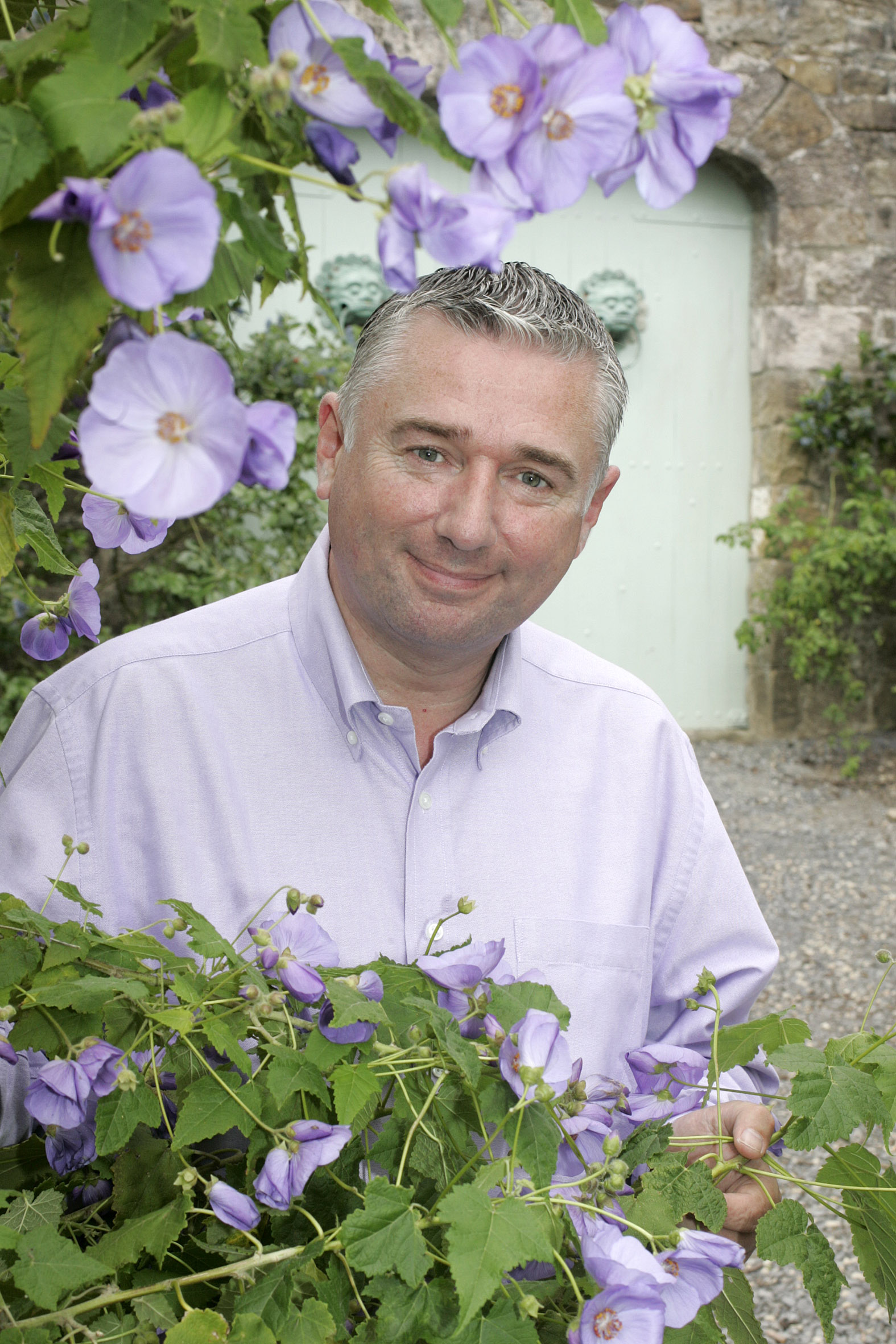 Dermot O'Neill relaxes in his walled garden at Clondeglass , co Laois. Pix Ronan Lang/Feature File for weekend mag